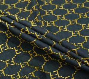 Dżins bawełniany Fendi z haftem złotego logo