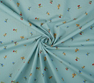 Bawełna kreszowana - kwiaty na miętowym tle