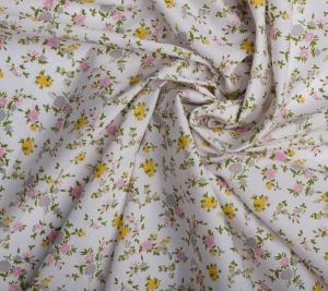 Bawełna żółto-różowe kwiaty na białym tle