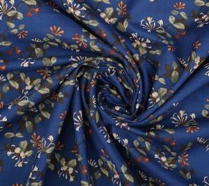 Bawełna - kwiaty na niebieskim tle